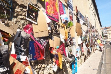 Flyers which take up miles of wall space for Avignon Festival