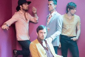 Kings of Leon surrounded by walls